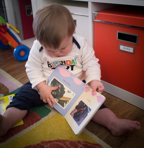 Opening his new book – tearing off the wrapping paper