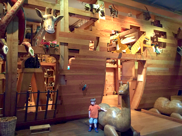 Noah's ark, three stories tall, animals' heads poking out